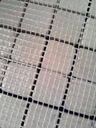 Mesh on reverse of a mosaic sheet